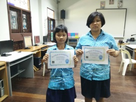 Students receive certificates after completing the program.
